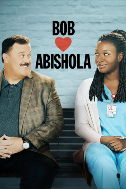 Bob Hearts Abishola: Season 2 - Billy Gardell and Folake Olowofoyeku looking at each other on bench