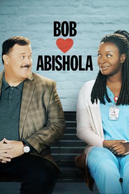 Bob Hearts Abishola: Season 2 - Billy Gardell and Folake Olowofoyeku looking at each other on bench