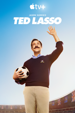 Ted Lasso: Season 1 - Jason Sudeikis as Ted Lasso holding a football wearing a black jersey and pant