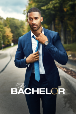 The Bachelor: Season 25 - Matt James wearing a blue tuxedo adjusting blue tie