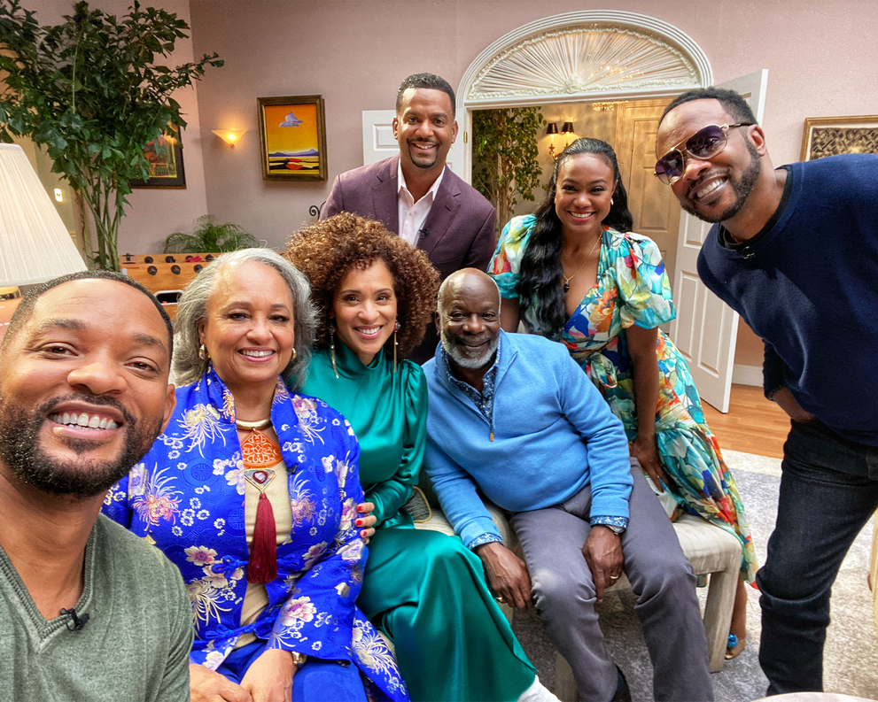 The Fresh Prince of Bel-Air Reunion - Special - Cast sitting on a couch smelling at the group selfie with Will Smith